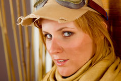 Young woman sunburned face with pilot goggles. Close-up Royalty Free Stock Photos
