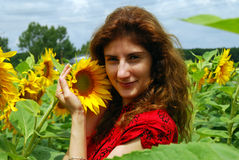 Young Woman in a Sunflower Field Stock Photo