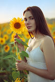 Young woman with sunflower Royalty Free Stock Image