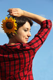 Young woman with a sunflower Stock Images