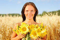Young woman with sunflowers Royalty Free Stock Photography