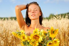 Young woman with sunflowers Royalty Free Stock Image