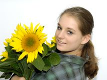 Young woman with sunflowers Royalty Free Stock Photos
