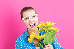 Young woman with sunflowers Stock Images