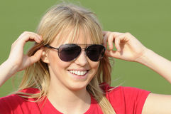 Young woman with sunglasses Stock Images