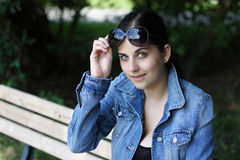 Young woman with sunglasses Stock Photography