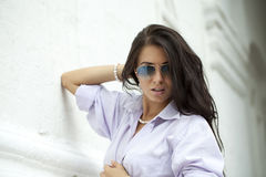 young woman in sunglasses Stock Photography