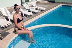 Young woman in sunglasses and bikini stock image