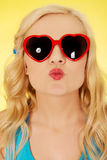 Young woman in sunglasses blowing lips kiss Stock Photo