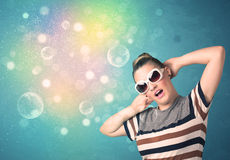 Young woman with sunglasses and bokeh colourful lights Royalty Free Stock Image