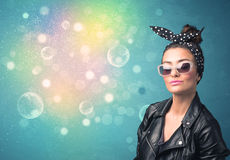 Young woman with sunglasses and bokeh colourful lights Stock Photos