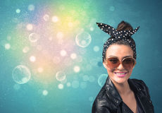 Young woman with sunglasses and bokeh colourful lights Royalty Free Stock Photography