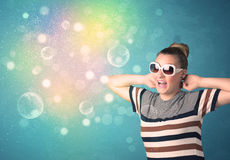 Young woman with sunglasses and bokeh colourful lights Stock Images