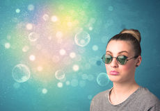 Young woman with sunglasses and bokeh colourful lights Royalty Free Stock Images