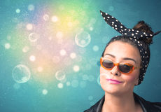 Young woman with sunglasses and bokeh colourful lights Stock Image