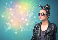 Young woman with sunglasses and bokeh colourful lights Royalty Free Stock Photos