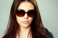 Young woman in sunglasses Royalty Free Stock Photography