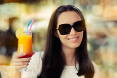 Young Woman with Sunglasses and Colorful Cocktail Drink Outside Royalty Free Stock Photography