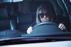 Young woman with sunglasses driving Stock Photo