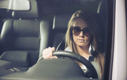 Young woman with sunglasses driving Stock Photography
