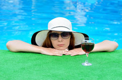 Young woman in sunglasses and a hat with a wine glass, a summer Stock Photo