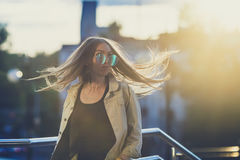Young woman in sunglasses have fun with outdoor, sunset in the background. Young woman have fun with an outdoor swing, sunset in the background. With custom royalty free stock photos