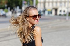 Young woman in sunglasses looking back outdoor Royalty Free Stock Photos