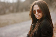 Young woman in sunglasses outdsoor portrait Royalty Free Stock Photography