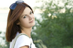 Young woman with sunglasses in the park Stock Images