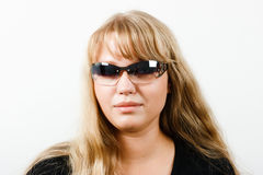 Young woman in sunglasses Royalty Free Stock Image