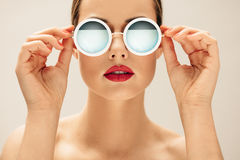 Young woman in sunglasses and red lips Royalty Free Stock Photography