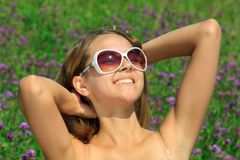 Young woman in sunglasses resting Stock Photos