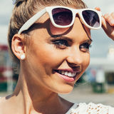 Young woman with sunglasses smiling Royalty Free Stock Photo