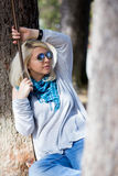 Young woman with sunglasses on a swing Stock Photography