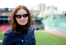 Young woman in sunglasses visiting a baseball park Royalty Free Stock Photo