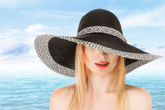 Young woman in sunhat Royalty Free Stock Image