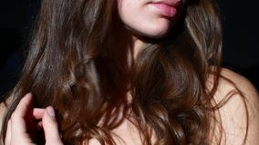 Young woman in the sunlight. Brilliant curls.  stock footage