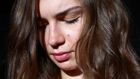 Young woman in the sunlight. Brilliant curls.  stock video footage