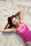 Young woman sunning on the beach Royalty Free Stock Photography