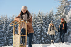 Young woman sunny winter lean against sledge royalty free stock photos
