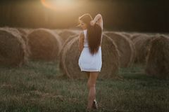 Young woman on sunrise field. Young healthy sensual woman on the sunrise field Stock Photo