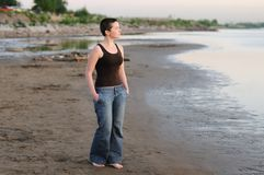 Young woman at sunset Stock Image