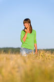Young woman in sunset corn field Stock Photos