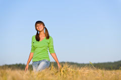 Young woman in sunset corn field Royalty Free Stock Photos