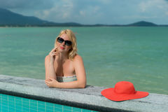 Young woman suntanning near pool Royalty Free Stock Images