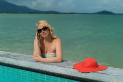 Young woman suntanning near pool Stock Photography