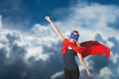 Young woman superhero in superwoman costume. Stock Image