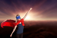 Young woman superhero in superwoman costume. Royalty Free Stock Photography