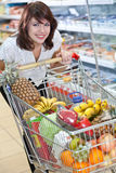 Young woman in the supermarket Royalty Free Stock Photos