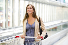 Young woman at supermarket. Young woman shopping at supermarket Royalty Free Stock Photos